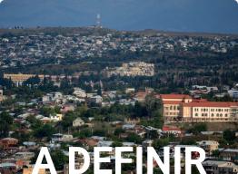 imagem de uma cidade e a palavra A DEFINIR representando o calendário mei para um país ainda não definido